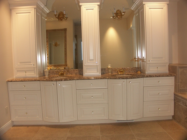 white painted bathroom cabinets with radius doors